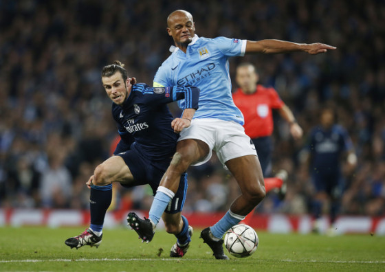 Football Soccer - Manchester City v Real Madrid - UEFA Champions League Semi Final First Leg - Etihad Stadium, Manchester, England - 26/4/16 Real Madrid's Gareth Bale in action with Manchester City's Vincent Kompany Reuters / Phil Noble Livepic EDITORIAL USE ONLY.