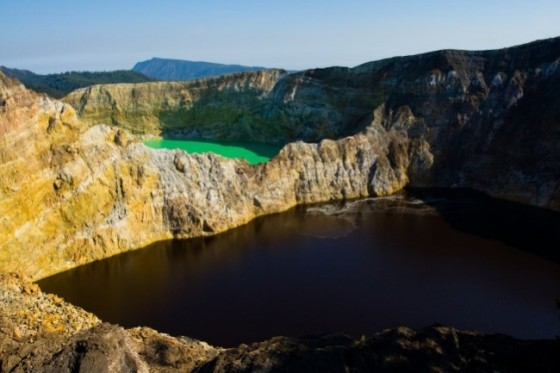 419605-r3l8t8d-650-adjacent-green-and-red-brown-volcanic-lake-at-kelimutu-national-park-indonesia-651x434