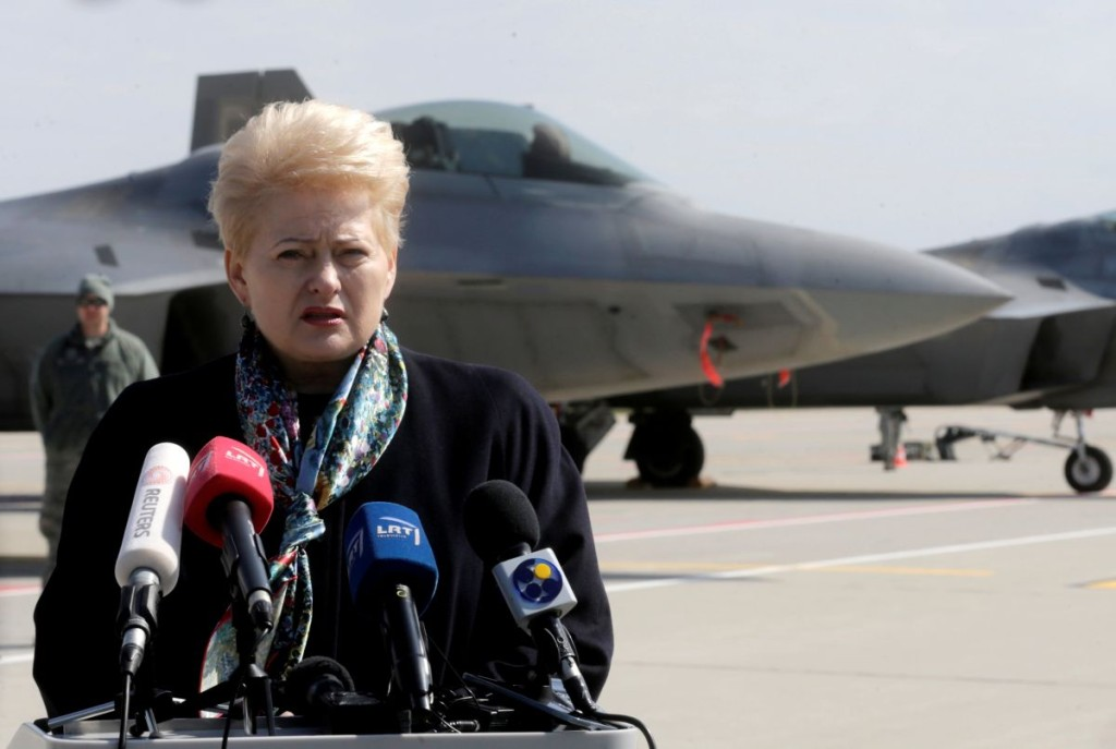 Lithuanian President Dalia Grybauskaite speaks to media in front of the U.S. Air Force F-22 Raptor fighters in the military air baser in Siauliai, Lithuania, April 27, 2016. REUTERS/Ints Kalnins