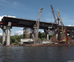 Як сім'я-мафіозі заробила мільйони на ремонті скандального моста Дніпра