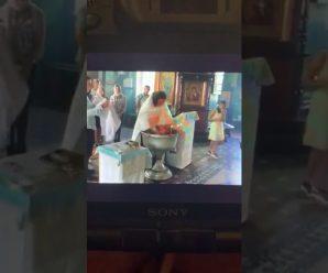 Дитя несамовито кричало: священик РПЦ сильно травмував дитину під час хрещення (відео)