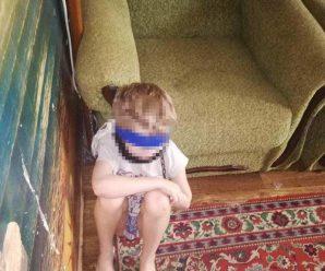 Обмотала скотчем і прикувала: Жінка тримала дитину на ланцюгу